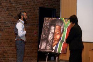 Victor Emmanuel presenting a split portrait of Nelson Mandela to Navi Pillay