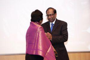 Fr. Joseph Chandrakanthan presenting a shawl to Navi Pillay